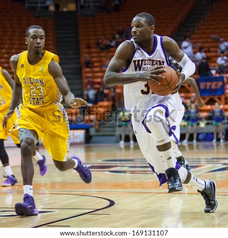 EL PASO, TEXAS -Â?Â? DECEMBER 29.  Covington (31) of Western Illinois drives as Myles (23) of Alcorn State guards in the Invitational Tournament on December 29, 2013 in El Paso, Texas.    - stock photo