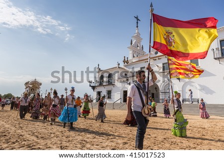 El ROCIO, ANDALUCIA, SPAIN - MAY 22: Romeria after visiting the Sanctuary goes to village.  2015  It is one of the most famous pilgrimage of Spain. This pilgrimage passes from the 15th century. - stock photo