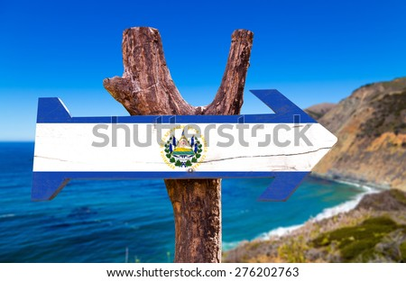 El Salvador Flag wooden sign with coast background - stock photo