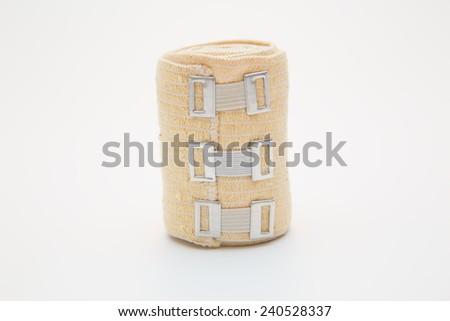 elastic bandage on a roll - stock photo