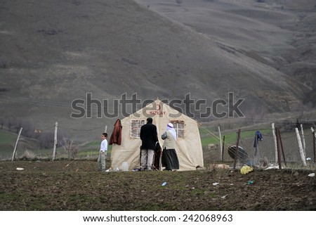 ELAZIG, TURKEY - MARCH 09:  Houses ruined during the earthquake of Elazig. families living in tents on March 09, 2010 in Elazig, Turkey.  - stock photo
