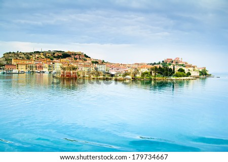 Elba island, Portoferraio village harbor and skyline from a ferry boat. Tuscany, Italy. - stock photo