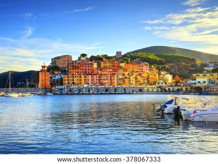 Elba island, Rio Marina village bay. Bay beach and lighthouse. Tuscany, Italy, Europe. - stock photo