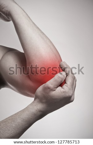 Elbow pain isolated injury concept - stock photo
