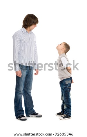 Elder and younger brothers of question poses. Isolated on white. - stock photo