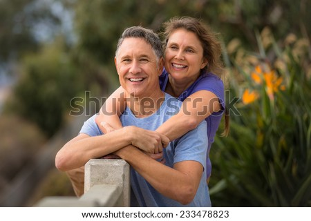 Elder couple looking at the horizon  - stock photo