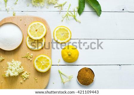 elder flower drink ingredients on white wood kitchen table background - stock photo