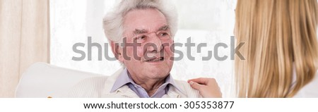 Elder man has lots of support from his family - stock photo