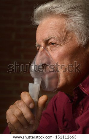 elder man in a shirt on a brick background - stock photo