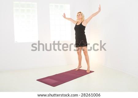 Elder woman dressed sportswear working out. - stock photo