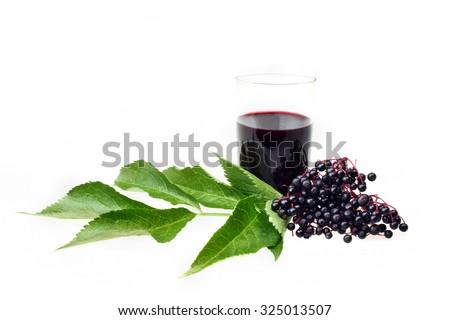 Elderberry wine and elderberries on white isolated background - stock photo