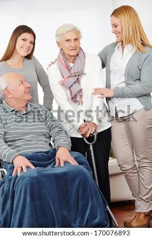 Eldercare nursing service at home for senior citizen couple - stock photo