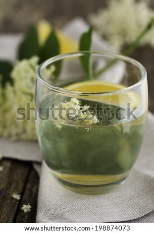 Elderflower cordial in a glass - stock photo