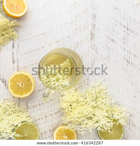 Elderflower syrup. Homemade elder flower syrup with a slice of lemon. Top view with copyspace - stock photo