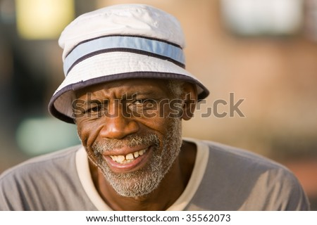 Elderly African American man smiling. - stock photo