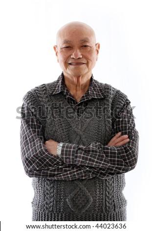 elderly asian man standing against white background - stock photo