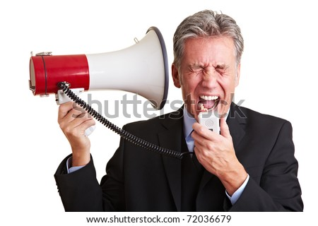Elderly business man screaming loudly in a megaphone - stock photo