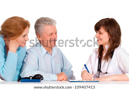 Elderly couple came to the reception to the young doctor - stock photo