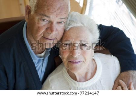 Elderly couple embracing - stock photo