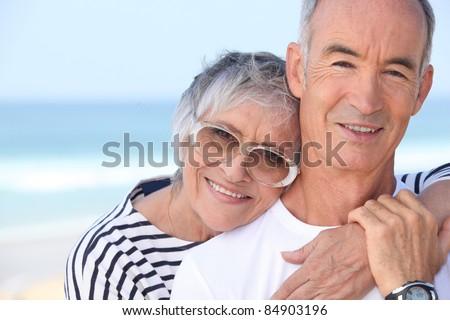 elderly couple enjoying holiday - stock photo