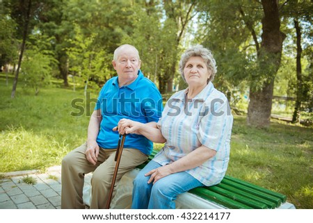 Elderly couple relaxing in the park, - stock photo