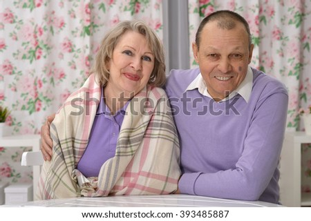 elderly couple resting at his desk - stock photo