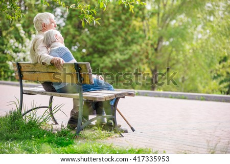 Elderly couple resting at the park - stock photo