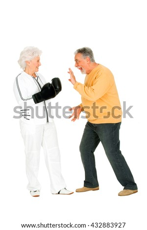 elderly couple with boxing gloves - stock photo