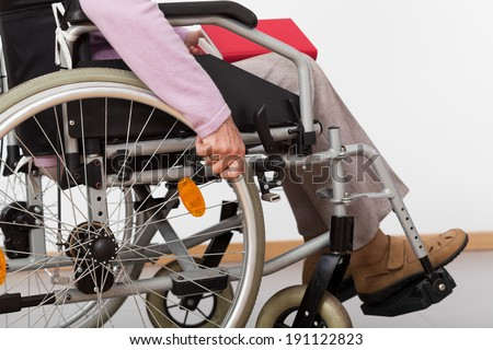 Elderly, disabled person sitting on wheelchair, horizontal - stock photo