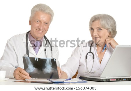 Elderly doctors with a laptop and x-ray on a white - stock photo