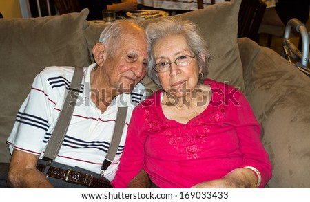 Elderly eighty plus year old couple in an affectionate pose. - stock photo