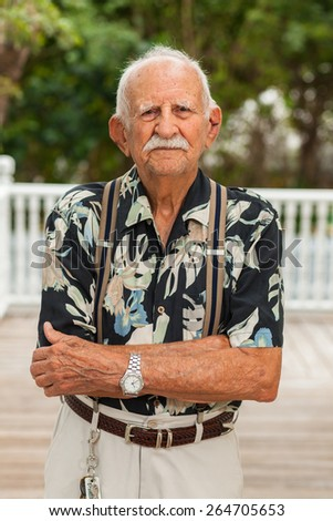 Elderly eighty plus year old man outdoor portrait. - stock photo