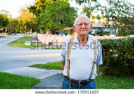 Elderly eighty plus year old man outdoors in a home setting. - stock photo