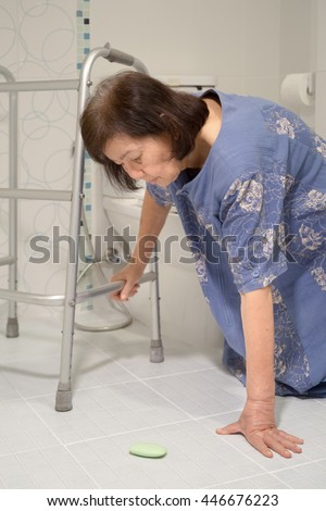 elderly falling in bathroom because slippery surfaces - stock photo