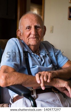 Elderly handicapped 80 plus year old man in a home setting. - stock photo