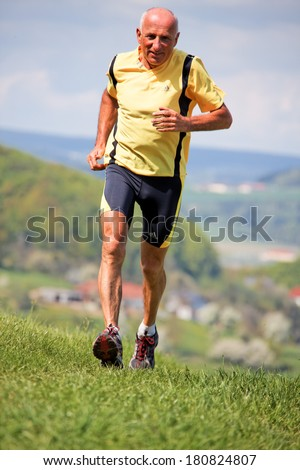 elderly joggers trained for his fitness by jogging - stock photo