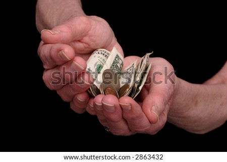 elderly ladies hands outstretched with money. - stock photo