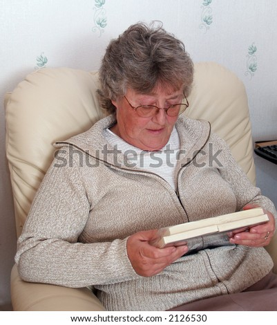 Elderly lady sorting out her christmas cards - stock photo