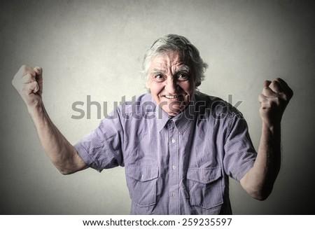 Elderly man jubilating  - stock photo