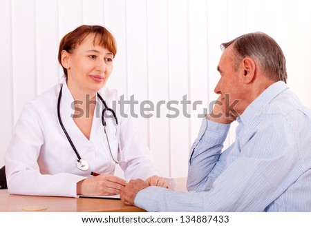 elderly man on  survey of  doctor - stock photo