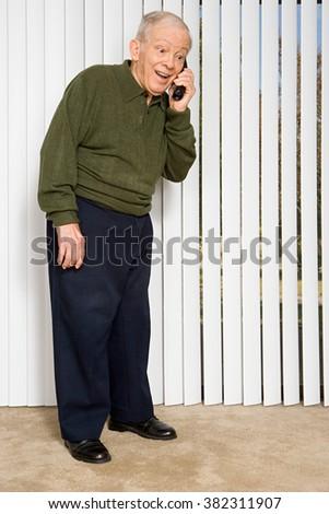 Elderly man on the telephone - stock photo