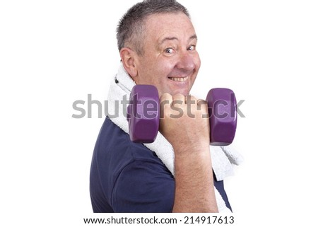 Elderly man with dumbbells during sport - stock photo