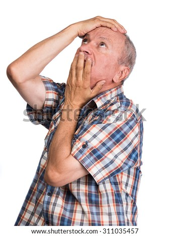Elderly man with hands near his face looking up isolated on white background - stock photo