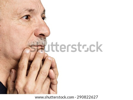 Elderly man with hands near his face looking up isolated on white background with copy-space  - stock photo