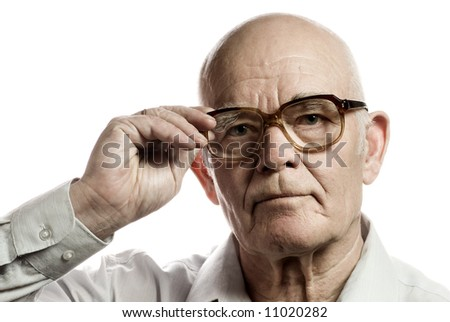 Elderly man with massive glasses isolated on white background - stock photo
