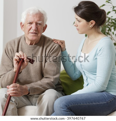 Elderly man with walking stick - stock photo