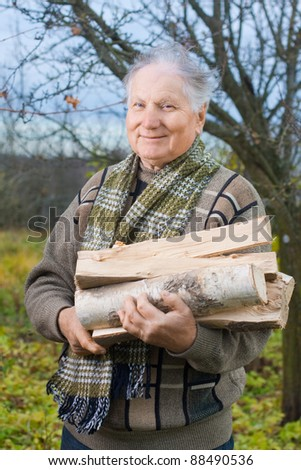 elderly men with firewood - stock photo