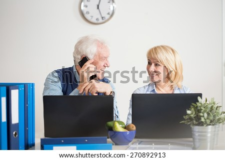 Elderly people running a company from home office - stock photo