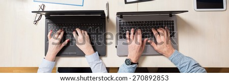 Elderly people using technology at their work - stock photo
