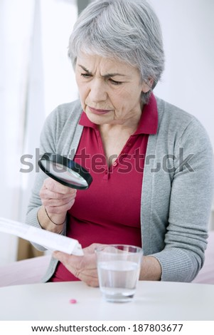 Elderly Person Taking Medication - stock photo